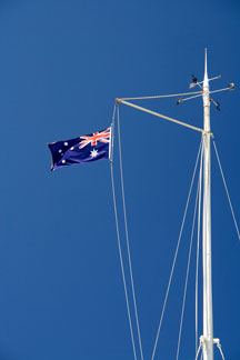 Australian flag flying from a ship's rigging